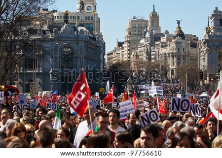 MADRID - MAR 11: Protest World Revolution for real Democracy, the labor reform law of the Partido Popular and the economy crisis in Madrid on March 11, 2012. - stock photo
