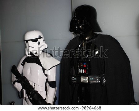 MADRID - MARCH 28: Storm Trooper and Darth Vader. Star Wars exhibition during the presentation of the new Star Wars game for Kinect XBOX 360 at the Sports Palace on March 28, 2012 in Madrid - stock photo