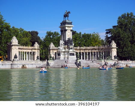 MADRID-MAY 7:  Unidentified people are seen in row boats and relaxing on steps of monument to King Alfonso XII in Retiro Park Madrid Spain on May 7, 2015.