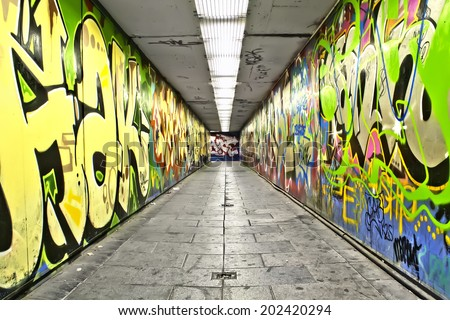 MADRID - MAY 27: Urban pedestrians tunnel with painted graffiti on the walls in Madrid. May 27, 2014 in Madrid.
