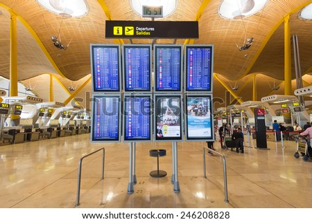 MADRID - OCT 11: Departure information boards at Madrid Barajas International Airport on Oct 11, 2014 in Madrid, Spain.  The airport is Spain's largest and busiest airport, and Europe's sixth busiest. - stock photo