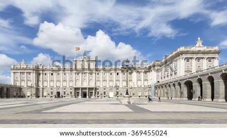 Madrid - 6 October 2015: Big, beautiful huge Armory Square Royal Palace of Madrid and the people walking and exploring the sights October 6, 2015, Madrid, Spain