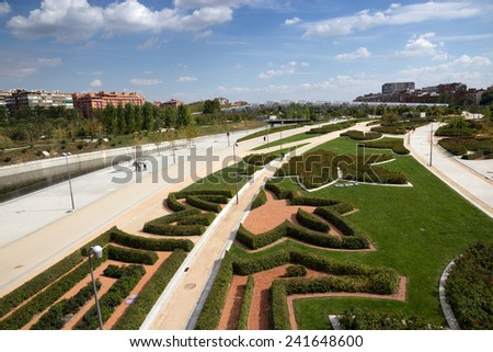 MADRID - OCTOBER 04:Madrid Rio Park on Manzanares River on October 04, 2014 in Madrid. This is the main landscaped area in Madrid. Pedestrian and cycling routes cover the whole park.  - stock photo