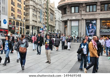 MADRID - OCTOBER 24: People shop downtown on October 24, 2012 in Madrid. Madrid is a popular tourism destinations with 3.9 million estimated annual visitors (official data). - stock photo