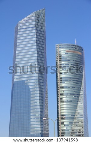 MADRID - OCTOBER 23: Torre de Cristal and Torre Espacio buildings on October 23, 2012 in Madrid. Torre de Cristal is 249.5 tall and is 2nd tallest building in Spain (2013).
