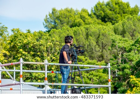 MADRID - SEP 10: A cameraman worker recording outdoors at Dcode Music Festival on September 10, 2016 in Madrid, Spain.