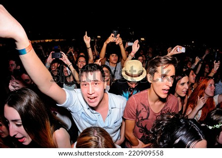 MADRID - SEP 13: People have fun in a concert at Dcode Festival on September 13, 2014 in Madrid, Spain. - stock photo