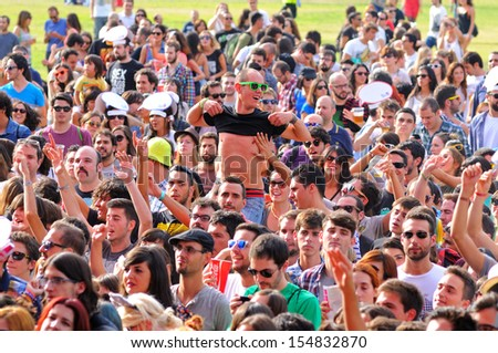 MADRID - SEPT 14: People from the audience at Dcode Festival on September 14, 2013 in Madrid, Spain. - stock photo