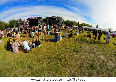 MADRID - SEPT 14: People sitting on the grass at Dcode Festival on September 14, 2013 in Madrid, Spain. - stock photo