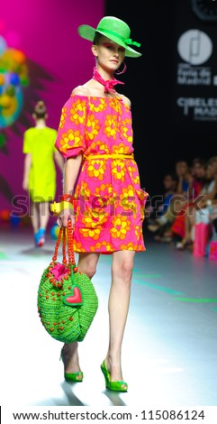 MADRID-Â?Â? SEPTEMBER 17: A model walks on the Agatha Ruiz de la Prada catwalk during the Cibeles Madrid Fashion Week runway on September 17, 2011 in Madrid, Spain. - stock photo