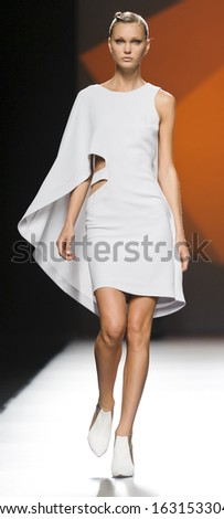 MADRID - SEPTEMBER 14: A model walks on the Amaya Arzuaga catwalk during the Cibeles Madrid Fashion Week runway on September 14, 2013 in Madrid.  - stock photo
