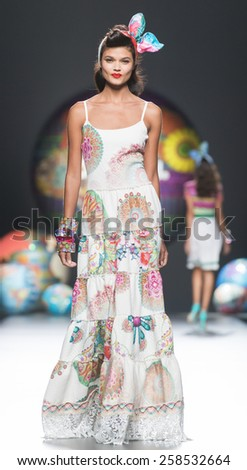 MADRID - SEPTEMBER 11: a model walks on the Desigual catwalk during the Mercedes-Benz Fashion Week Madrid Spring/Summer 2015 runway on September 11, 2014 in Madrid.  - stock photo