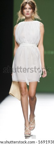 MADRID - SEPTEMBER 14: A model walks on the Devota & Lomba catwalk during the Cibeles Madrid Fashion Week runway on September 14, 2013 in Madrid.  - stock photo