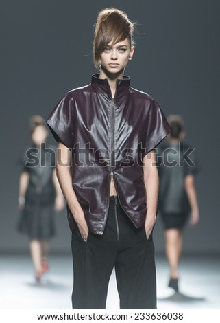 MADRID - SEPTEMBER 13: a model walks on the Etxebarria catwalk during the Mercedes-Benz Fashion Week Madrid Spring/Summer 2015 runway on September 13, 2014 in Madrid.