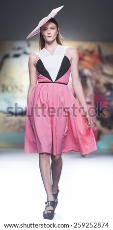 MADRID - SEPTEMBER 12: a model walks on the Ion Fiz catwalk during the Mercedes-Benz Fashion Week Madrid Spring/Summer 2015 runway on September 12, 2014 in Madrid.  - stock photo