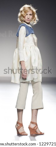 MADRID - SEPTEMBER 04: A model walks on the Isabel Ruiz catwalk during the Cibeles Madrid Fashion Week runway on September 04, 2012 in Madrid.