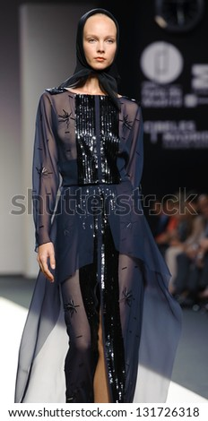 MADRID - SEPTEMBER 16: A model walks on the Jesus del Pozo  catwalk during the Cibeles Madrid Fashion Week runway on September 16, 2011 in Madrid.