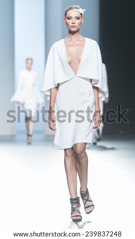 MADRID - SEPTEMBER 13: a model walks on the Juana Martin catwalk during the Mercedes-Benz Fashion Week Madrid Spring/Summer 2015 runway on September 13, 2014 in Madrid.