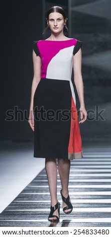MADRID - SEPTEMBER 12: a model walks on the Juanjo Oliva catwalk during the Mercedes-Benz Fashion Week Madrid Spring/Summer 2015 runway on September 12, 2014 in Madrid.  - stock photo