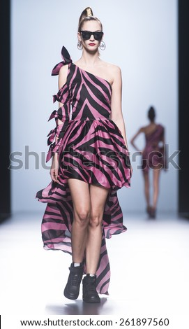 MADRID - SEPTEMBER 15: a model walks on the Maria Escote catwalk during the Mercedes-Benz Fashion Week Madrid Spring/Summer 2015 runway on September 15, 2014 in Madrid.  - stock photo