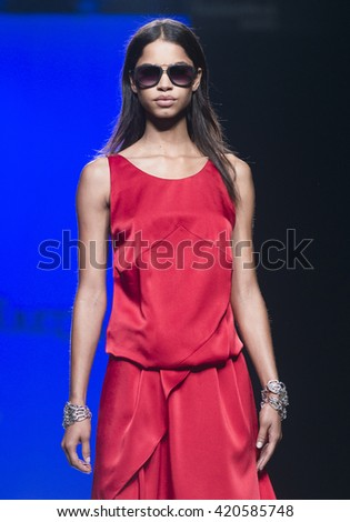 MADRID - SEPTEMBER 19: a model walks on the Roberto Torretta catwalk during these Mercedes-Benz Fashion Week Madrid Spring/Summer 2016 runway on September 19, 2015 in Madrid.  - stock photo
