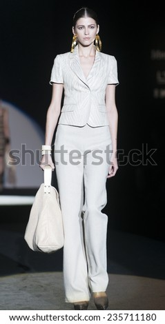 MADRID - SEPTEMBER 12: a model walks on the Roberto Verino catwalk during the Mercedes-Benz Fashion Week Madrid Spring/Summer 2015 runway on September 12, 2014 in Madrid.  - stock photo