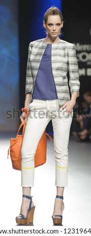 MADRID - SEPTEMBER 02: A model walks on the Sara Coleman catwalk during the Cibeles Madrid Fashion Week runway on September 02, 2012 in Madrid. - stock photo