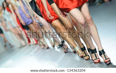 MADRID - SEPTEMBER 18: Details of models walking on the Amaya Arzuaga catwalk during the Cibeles Madrid Fashion Week runway on September 18, 2011 in Madrid. - stock photo