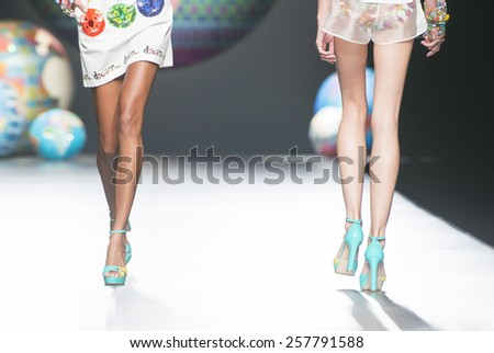 MADRID - SEPTEMBER 11: details of models walking on the Desigual catwalk during the Mercedes-Benz Fashion Week Madrid Spring/Summer 2015 runway on September 11, 2014 in Madrid.  - stock photo