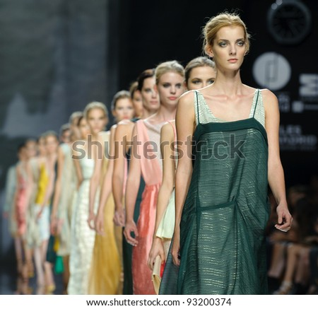 MADRID – SEPTEMBER 18: Models walk on the Ailanto catwalk during the Cibeles Madrid Fashion Week runway on September 18, 2011 in Madrid, Spain. - stock photo