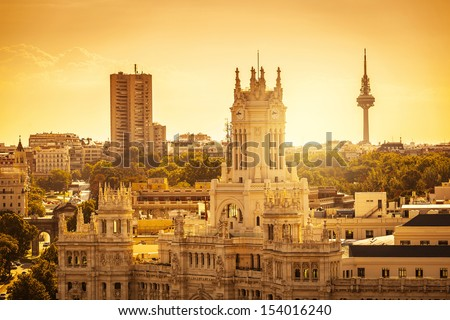 Madrid Skyline with Palacio de Comunicaciones and Alcala Gate - stock photo
