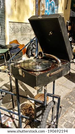 MADRID, SPAIN - APRIL 27: A record-player in the Rastro of Madrid. It's an outdoor market, originally from second-hand objects, each morning is mounted. April 27, 2014 in Madrid, Spain