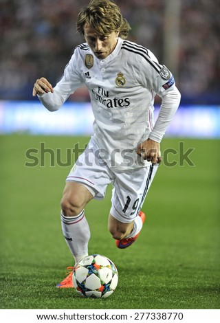 MADRID, SPAIN -  April 22nd, 2014 :  LUKA MODRIC of REAL MADRID in action during Europe Champions League match vs ATLETICO DE MADRID at Santiago Bernabeu Stadium  - stock photo