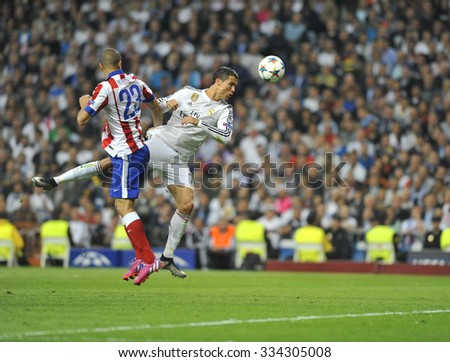 MADRID, SPAIN - April 22th, 2015 :  CRISTIANO RONALDO of REAL MADRID in action head kick during Europe Champions League match vs ATLETICO DE MADRID at Santiago Bernabeu Stadium  - stock photo