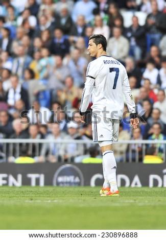 MADRID, SPAIN - April 20th, 2013 : Portuguese football superstar of Real Madrid CRISTIANO RONALDO in action of spitting during La Liga match at Santiago Bernabeu Stadium.  - stock photo