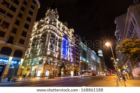 MADRID, SPAIN - APRIL 26: Wide angle shot of Gran Via in night in April 26, 2013 in Madrid, Spain. Gran Via one of broadest and most important avenues at city