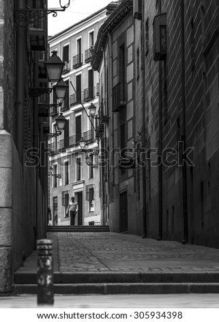 Madrid, Spain - August 12. 2015: A person walks through the old part of Madrid a summer afternoon