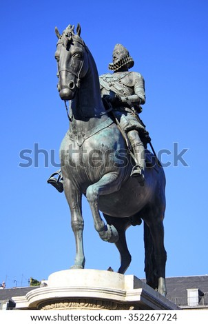MADRID, SPAIN - AUGUST 23, 2012: Bronze equestrian statue of King Philip III from 1616 at the Plaza Mayor in Madrid, Spain.