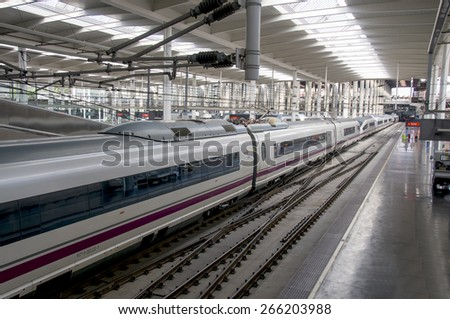 MADRID SPAIN August 31: High speed train in Atocha Station on August 31, 2014 in Madrid, Spain. Spain's main cities are connected by high-speed trains.