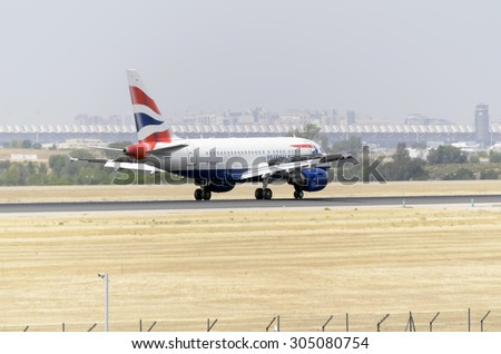 MADRID, SPAIN - AUGUST 8th 2015: Aircraft -Airbus A318-112-, of -British Airways- airline, is landing on Madrid-Barajas -Adolfo Suarez- airport, on August 8th 2015. - stock photo
