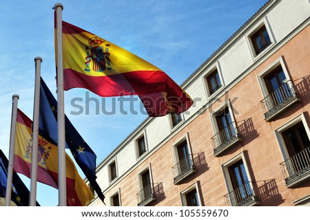 Madrid, Spain cityscape. Spanish flags wave in Madrid city, Spain. - stock photo