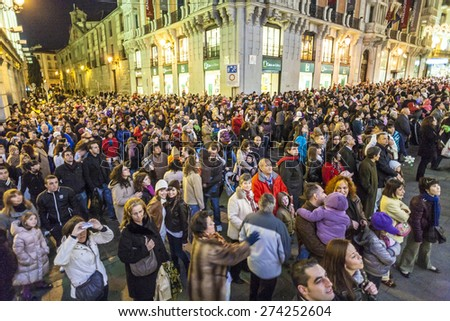 MADRID, SPAIN - DEC 20, 2010: People have fun in Christmas time watching the famous puppet show and illumination at center El Corte Ingles in Madrid, Spain.