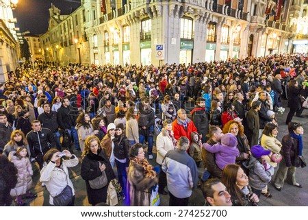 MADRID, SPAIN - DEC 20, 2010: People have fun in Christmas time watching the famous puppet show and illumination at center El Corte Ingles in Madrid, Spain. - stock photo