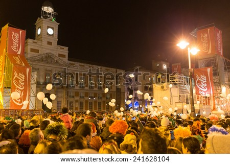 MADRID, SPAIN - DECEMBER 31, 2014: The famous Puerta del Sol crowded with tourists on December 31 in Madrid. Puerta del Sol traditionally is the centre of New Year celebrations each year in Madrid. - stock photo