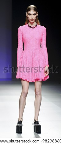 MADRID, SPAIN -  FEBRUARY 04: A model walks on the Maria Escote catwalk during the Mercedes-Benz Fashion Week Madrid runway on February 04, 2012 in Madrid, Spain. - stock photo