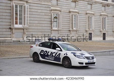 MADRID, SPAIN -1 FEBRUARY 2016- A police car in front of the Palacio Real de Madrid (Royal Palace), the ceremonial residence of the royal Spanish family.  - stock photo