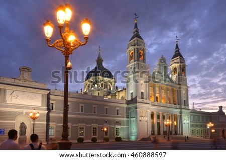 MADRID, SPAIN - FEBRUARY 17, 2012: Almudena Cathedral , near the royal palace , with lights on at sunset