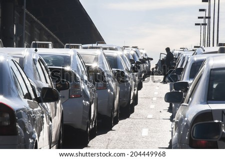 MADRID, SPAIN - FEBRUARY 2: Lots of white taxis wait in front of Atocha railway station on February 2, 2014 in Madrid, Spain.