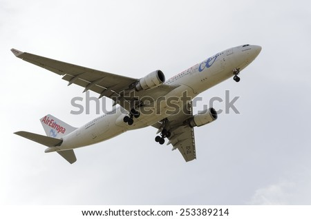 MADRID, SPAIN - FEBRUARY 14th 2015: Airplane -Airbus A330-200-, of -Air Europa- airline, landing on Madrid-Barajas -Adolfo Suarez- airport, on February 14th 2015. - stock photo
