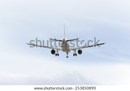 MADRID, SPAIN - FEBRUARY 14th 2015: Airplane -Airbus A319-100-, of -TAP Portugal- airline, landing on Madrid-Barajas -Adolfo Suarez- airport, on February 14th 2015. - stock photo
